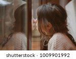 daughter reflecting sadness and ... | Shutterstock . vector #1009901992