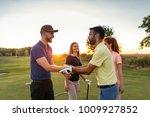 golfing partners shaking hands... | Shutterstock . vector #1009927852