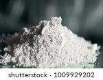 calcium hydroxide as a powder | Shutterstock . vector #1009929202