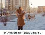 beauty winter girl playing snow ... | Shutterstock . vector #1009955752