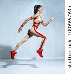 sporty woman runner in... | Shutterstock . vector #1009967935