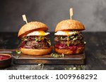 two homemade beef burgers with... | Shutterstock . vector #1009968292