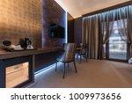 armchairs near window in... | Shutterstock . vector #1009973656