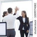 closeup.business team  giving... | Shutterstock . vector #1009974082