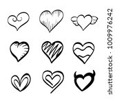 set of hand drawn hearts.... | Shutterstock .eps vector #1009976242