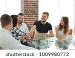 handshake of young employees | Shutterstock . vector #1009980772