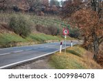 european country road. turn... | Shutterstock . vector #1009984078
