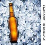 bottle of beer in ice cubes. | Shutterstock . vector #100998955