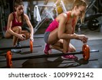 two attractive sporty fitness... | Shutterstock . vector #1009992142