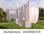 Fresh Clean White Sheet Drying...