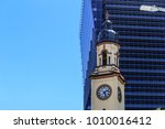 old clock tower with modern... | Shutterstock . vector #1010016412
