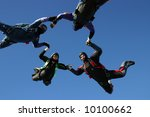 four skydivers form a circle | Shutterstock . vector #10100662