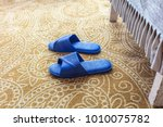 a pair of slippers in the... | Shutterstock . vector #1010075782