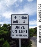 Small photo of A road sign warning that drivers must adhere to the left hand side of the road when driving in Australia.