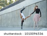 a young ballerina and a parkour ... | Shutterstock . vector #1010096536