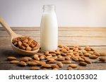 almond milk in bottle with... | Shutterstock . vector #1010105302