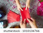 close up hands of parent giving ... | Shutterstock . vector #1010136766