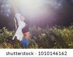 twenty year old girl in jeans... | Shutterstock . vector #1010146162