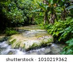 water flows down the mele... | Shutterstock . vector #1010219362