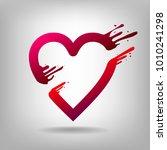 heart pierced by arrow amour. ... | Shutterstock .eps vector #1010241298