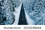 aerial view of snowy forest... | Shutterstock . vector #1010248666