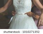 bride putting on the wedding...   Shutterstock . vector #1010271352