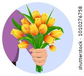 a man's hand gives a bouquet of ... | Shutterstock .eps vector #1010276758
