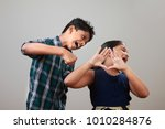 angry elder brother attcks his... | Shutterstock . vector #1010284876