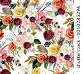 Stock photo seamless watercolor ethnic boho floral pattern vivid flowers feathers arrows on white 1010285296