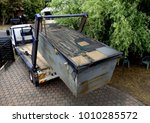 Small photo of Truck (lorry) loading a full skip waste management container