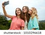 beautiful girls taking photos... | Shutterstock . vector #1010296618
