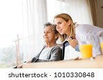 health visitor and a senior... | Shutterstock . vector #1010330848