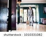 mature businessman entering... | Shutterstock . vector #1010331082