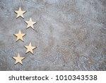 five wooden stars lie zigzag in ...