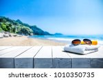 white beach towel with... | Shutterstock . vector #1010350735