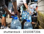 collecting natural spring water ... | Shutterstock . vector #1010387206