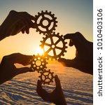 gears in the hands of a team of ...   Shutterstock . vector #1010403106