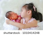 cute asian sister embracing and ... | Shutterstock . vector #1010414248