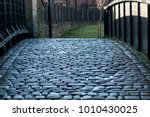 the dark and wet cobbled... | Shutterstock . vector #1010430025