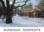 abandoned rural house in winter ... | Shutterstock . vector #1010432476