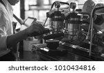 barista make coffee latte art... | Shutterstock . vector #1010434816