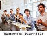 young team applause in meeting... | Shutterstock . vector #1010446525
