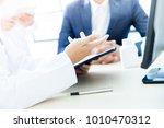 doctor explaining for patient... | Shutterstock . vector #1010470312