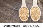 amaranth seeds in wooden spoon  ... | Shutterstock . vector #1010476222