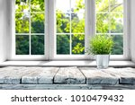 desk of free space with green... | Shutterstock . vector #1010479432