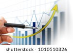 hand and graph on monitor screen | Shutterstock . vector #1010510326
