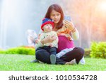 mother and little asian baby... | Shutterstock . vector #1010534728