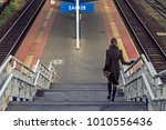woman on the stairs to the... | Shutterstock . vector #1010556436