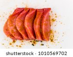 pork fillet chopped spices on a ... | Shutterstock . vector #1010569702