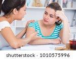 sad teenager girl sitting at... | Shutterstock . vector #1010575996